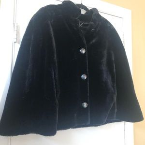 Fur cape with slits for arms